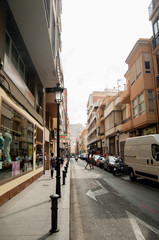 ALICANTE, SPAIN - JULY 14, 2015: Old street with city hall in sp