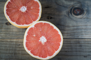 Sliced Grapefruit Cut in Half on Wooden Table