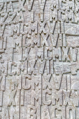 Roman numerals set in stone