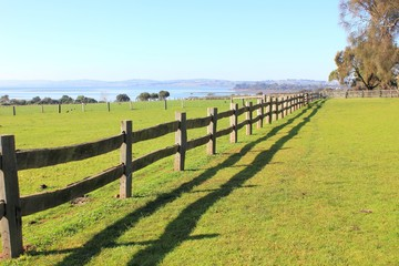 Old post and rail fence on rural coastal property in Australia