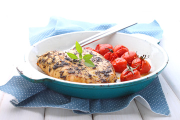 baked in a sauce of pesto chicken breast with cherry tomatoes