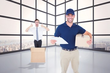 Composite image of happy delivery man with cardboard box