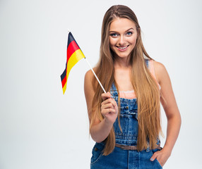 Casual girl holding Germany flag