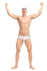 Overjoyed male swimmer celebrating victory
