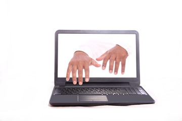 Hands are typing from inside the laptop
