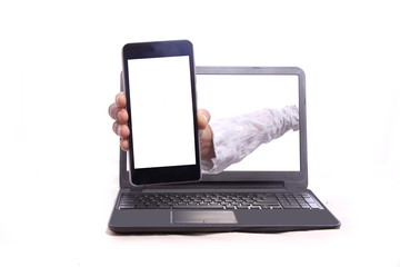Woman showing mobile phone from inside the laptop