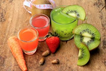 fresh kiwi juice and strawberry on wood vintage