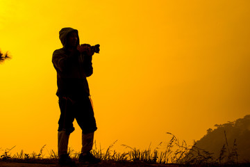 .Silhouette photographers take camera landscape