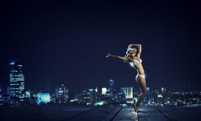 Girl dancing in dark