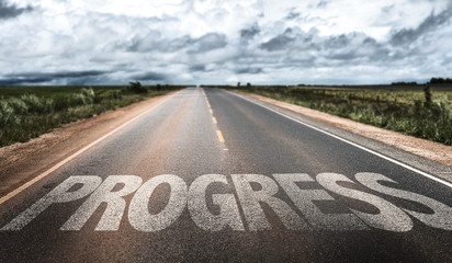 Progress written on rural road