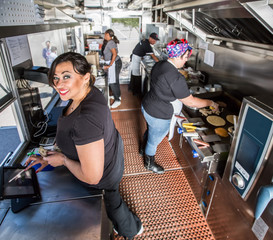 Happy Cashier in Busy Food Truck