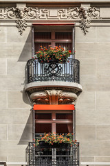 Traditional French house: balconies and windows. Paris, France.