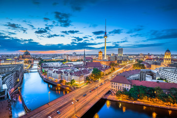 Berlin skyline panorama with dramatic clouds in twilight at dusk, Germany