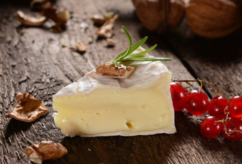 Camembert cheese on a rustic background