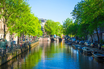 Beautiful canal in the old city of Amsterdam, Netherlands, North