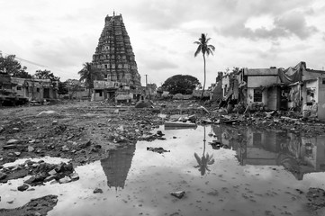 The architecture of Virupaksha Temple standing in the village of Hampi in Karnataka, India with the ruins of Hampi Bazaar, bulldozed in a controversial conservation effort