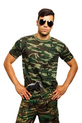 Young military man with a gun in his waistband
