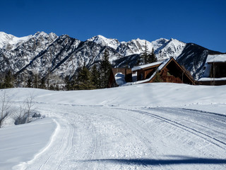 Groomed nordic ski trail with mountains and cabins in Colorado