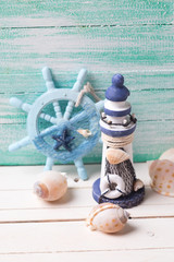 Decorative lighthouse,  helm and marine items
