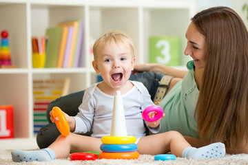 parent and child boy playing together at home