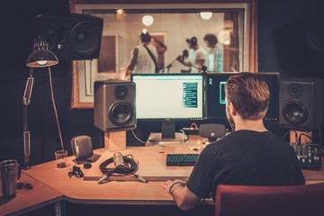 Music band during cd recording in studio Wall mural