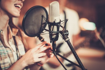 Woman singer in a recording studio Fotobehang