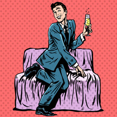 Playful man with a glass of champagne on the couch
