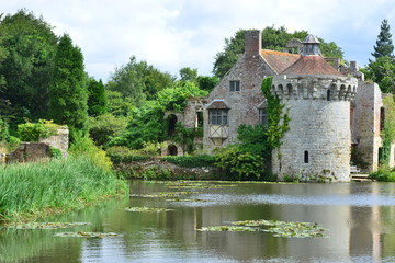 The ruins of an old English castle surrounded by a moat in Kent.