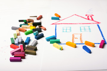 Design Concept for real estate - color dry pastel on a white and wooden background. Top view.