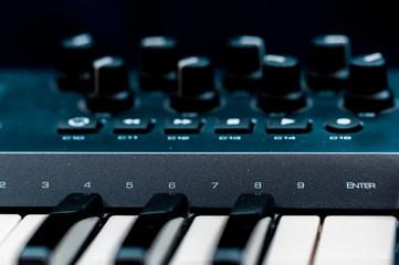 piano keys. close-up frontal view of keyboard