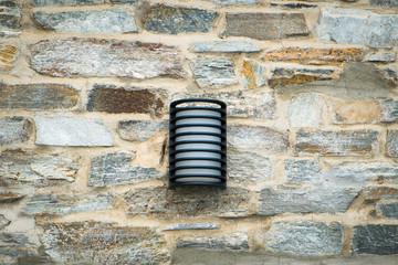 Lantern on a stone wall