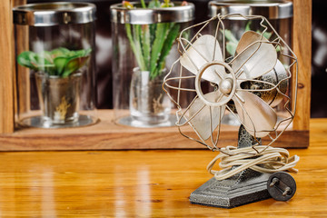 Dirty old vintage metal fan  on the table
