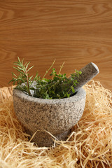 Healthy and fragrant herbs in a stone mortar