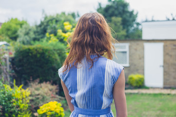 Young woman standing in garden