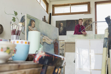 Portrait of a female artist smiling in her studio, Bavaria, Germany