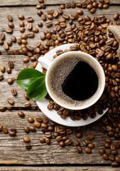 ground coffee in scoop and coffee beans on a wooden background, view from the top
