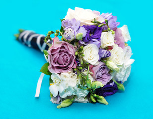 A wonderful bridal bouquet on a turquoise background