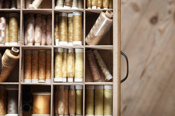 Spools of sewing threads in drawer