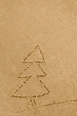 Chrismas tree drawing on sand