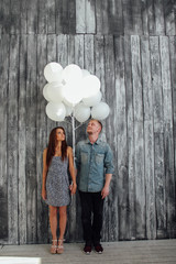 Boy and girl with baloons