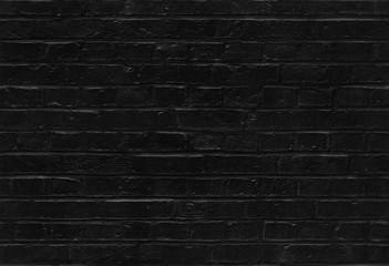 Seamless black brick wall pattern texture background