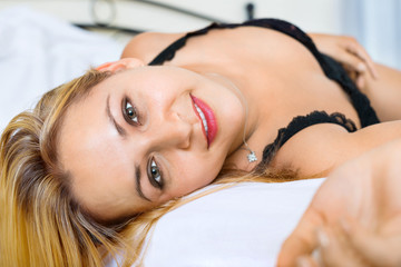 Sexy woman wearing underwear on bed
