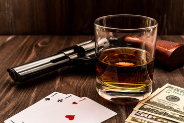 Fototapete - Glass of whiskey and playing cards with revolver and money on the wooden table