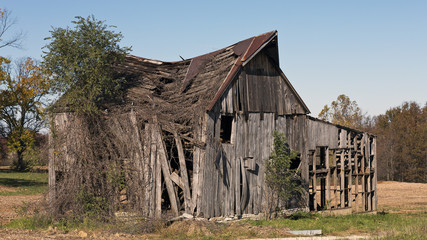 Landscape with a collapsing old barn