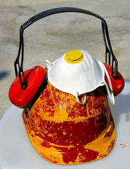 bucket with tools and construction safety equipment. Helmet, cap, mask, etc.
