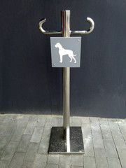 parking dogs with a sign
