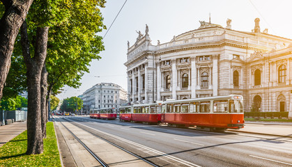 Fotorolgordijn Wenen Wiener Ringstrasse with Burgtheater and tram at sunrise, Vienna, Austria