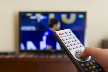 Television remote control in human hands