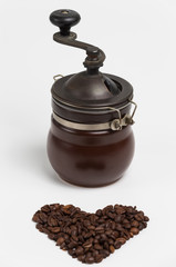 Heart shape made out of coffee beans. Coffee grinder