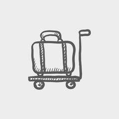 Luggage on a trolley sketch icon